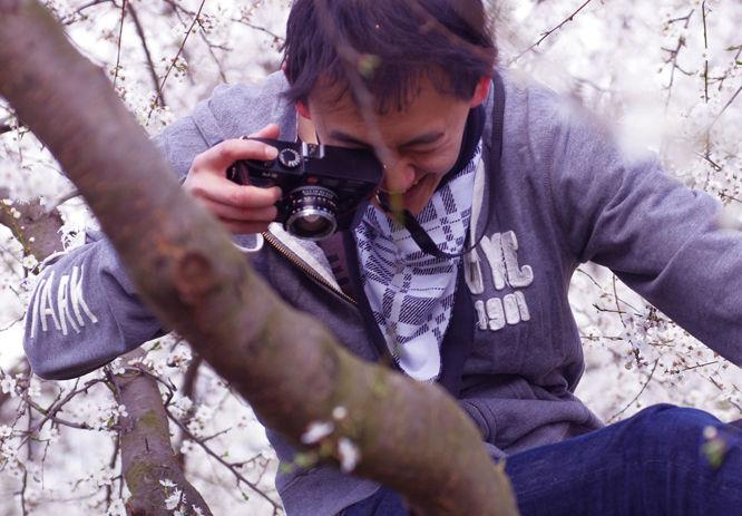Wayne Wong hanging in a tree to get the perfect photograph!